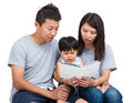 Asian parent reading booking with baby son isolated on white Royalty Free Stock Photo