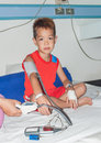 Asian patient boy with saline intravenous iv on hospital bed Royalty Free Stock Photography