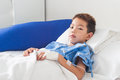 Asian patient boy with saline intravenous iv on hospital bed Royalty Free Stock Photo