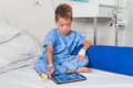 Asian patient boy with saline intravenous iv on hospital bed Stock Image