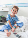 Asian patient boy with saline intravenous iv on hospital bed Stock Photos