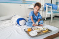 Asian patient boy with saline intravenous iv on hospital bed are eating Royalty Free Stock Photography