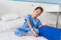 Asian patient boy with saline intravenous iv on hospital bed are eating medicines Stock Photography