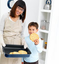 Asian people baking cookies at home Stock Image