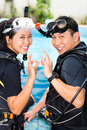 Asian people diver course diving school wetsuit oxygen tank Royalty Free Stock Photo