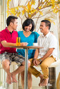 Asian people having fun together at bar table Stock Photography