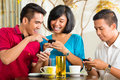 Asian people having fun together mobile phone drinking coffee cocktail Royalty Free Stock Photos