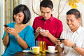 Asian people having fun together mobile phone drinking coffee cocktail Stock Images