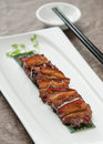 Asian pork served with braised sauce Royalty Free Stock Photography