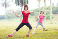 Asian practicing tai chi outdoor girls in the park Stock Images