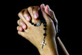 Asian Praying Hands With Silver Rosary Royalty Free Stock Photo