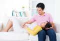 Asian pregnant couple having conversation home asian family living lifestyle Stock Photos
