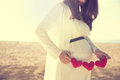 Asian pregnant woman holding heart shape accessories Royalty Free Stock Photo