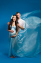 Asian pregnant woman in a silk dress Stock Photo