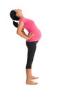 Asian pregnant woman stretching prenatal yoga full length healthy doing yoga exercise at home fullbody isolated on white Stock Photography