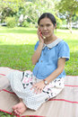 Asian pregnant women using smartphones call to doctor and query woman about in health care in the public park Royalty Free Stock Photos
