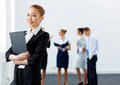 Asian pretty business woman with folder young women holding colleagues at background Stock Photography
