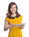 Asian pretty woman with tablet and smile - isolate Royalty Free Stock Photo
