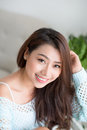 Asian pretty young woman relaxing at home. Royalty Free Stock Photo