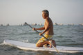 Asian retiree in his s in outdoor sea sports surf Stock Photography