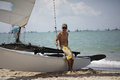 Asian retiree male sitting by the side of yacht in sailing sports Stock Photos