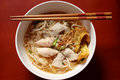 Asian rice noodle soup with pork, fish ball and crisps dumpling. Royalty Free Stock Photo