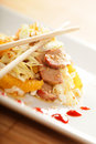 Asian salad with chopsticks Royalty Free Stock Images