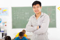 Asian school teacher happy male elementary in classroom Stock Images