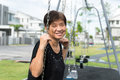 Asian senior citizen elderly woman is sitting on swing happily Royalty Free Stock Photos