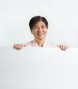 Asian senior citizen holding blank white board Stock Photos