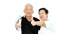 Asian Senior couple holding water bottle stay dydrate for health Royalty Free Stock Photo