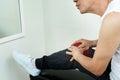 Asian senior man having Knee pain. Royalty Free Stock Photo