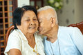Asian Senior man kissing senior woman