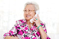 Asian senior woman in her s talking on the phone Royalty Free Stock Image