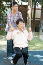 Asian senior women playing swing at outdoor garden park s old mother and s daughter Stock Images