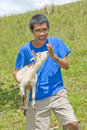 Asian shepherd with young goat Royalty Free Stock Photo