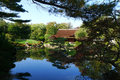The asian shofuso japanese teahouse with koi pond perfectly calm on a summers day Royalty Free Stock Photography
