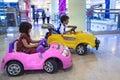 Asian sibbling riding car