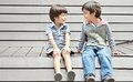 Asian sibling sitting together with smile withsmile Stock Photos