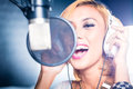 Asian singer producing song in recording studio Royalty Free Stock Photo