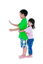 Asian sister hugging his brother smiling happily, isolated on wh Royalty Free Stock Photo