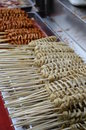 Asian skewers in bangkok street food tray with china Royalty Free Stock Photography