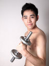 Asian skinny boy with bodybuilding photo of Royalty Free Stock Image