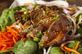 Asian sliced beef salad with spinach and carrots Royalty Free Stock Photos