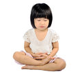 Asian small child doing meditation in buddhism practice Stock Images