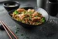 Asian soba noodle and teriyaki salmon  in black bowl Royalty Free Stock Photo