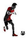 Asian soccer player young man silhouette one dribbling in isolated white background Stock Images