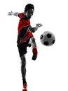 Asian soccer player young man silhouette one kicking in isolated white background Stock Images