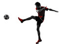 Asian soccer player young man silhouette one kicking in isolated white background Royalty Free Stock Image