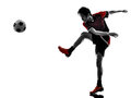 Asian soccer player young man silhouette one kicking in isolated white background Stock Photography